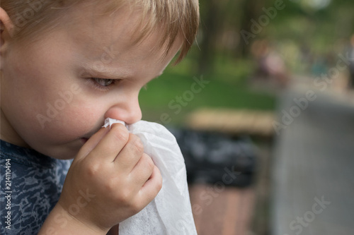 Runny nose with a little boy Fototapet