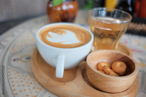 Fototapety, obrazy: Coffee in a white cup and tea on the table.
