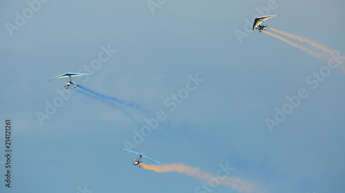Flex-wing trikes flying in sky on air show