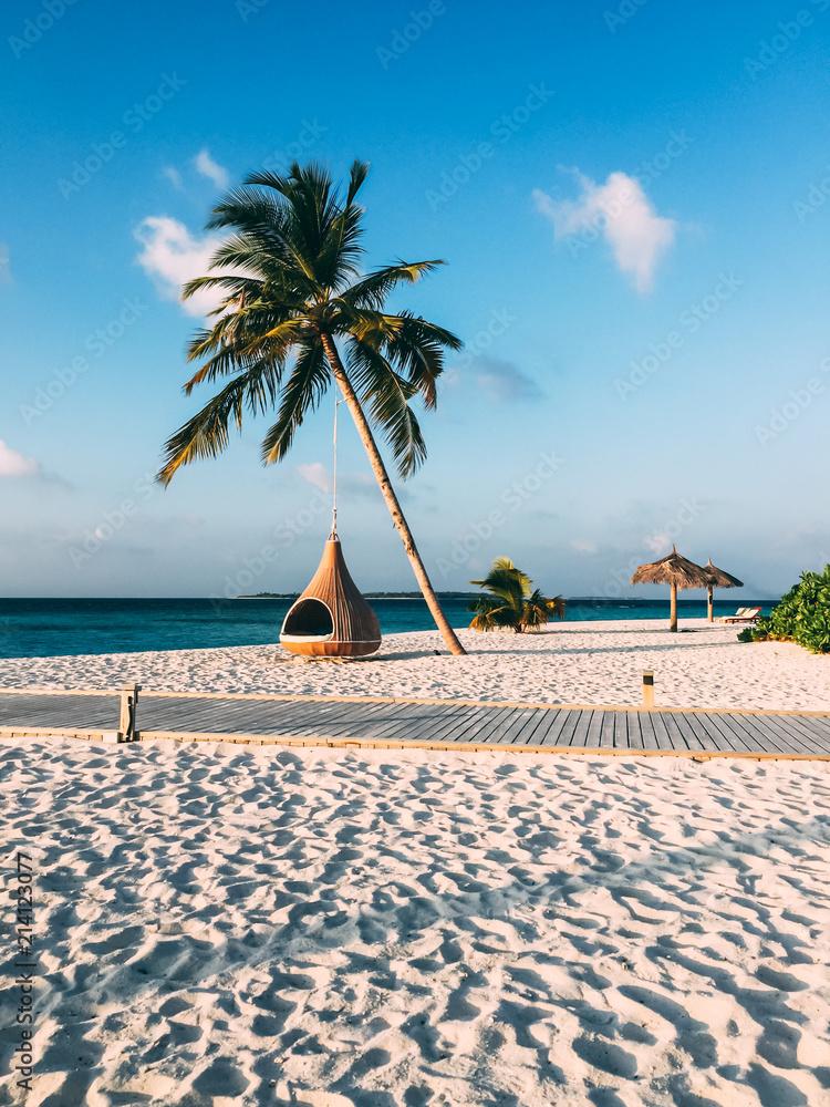 Fototapeta Maldives island luxury resort palm tree with hanging hammock
