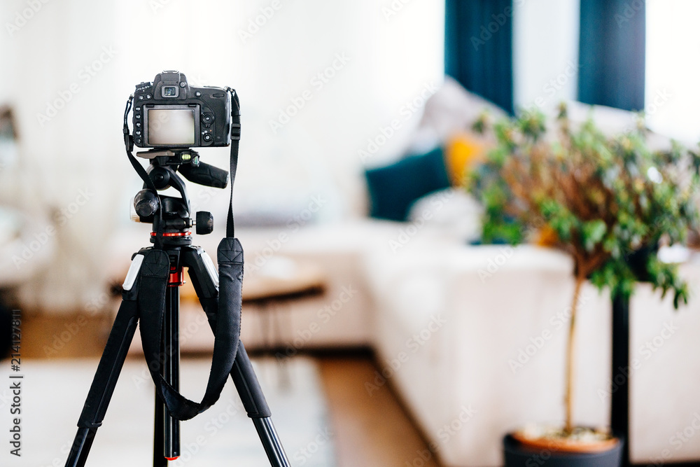 Fototapety, obrazy: Camera on a tripod taking photographs of interior design, furniture and houses