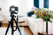 canvas print picture - Camera on a tripod taking photographs of interior design, furniture and houses
