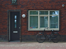 A Bike Next To The Door