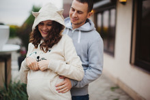 Pregnant Woman And Her Husband...