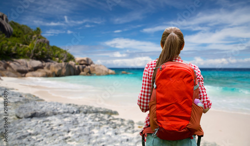 adventure, travel, tourism, hike and people concept - young woman with backpack Fototapeta