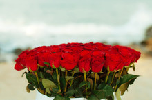 Bouquet Of Red Roses On Sea Background