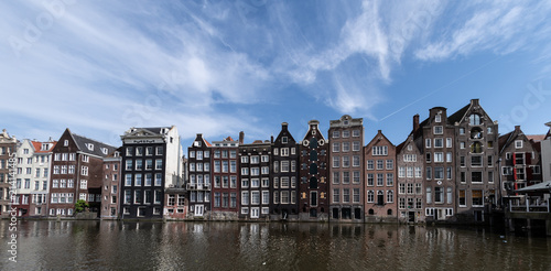 Poster Amsterdam Amsterdam, Netherlands, May 2018: Classic Amsterdam buildings on the water front