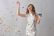 canvas print picture Beautiful young woman with drink and falling confetti on grey background