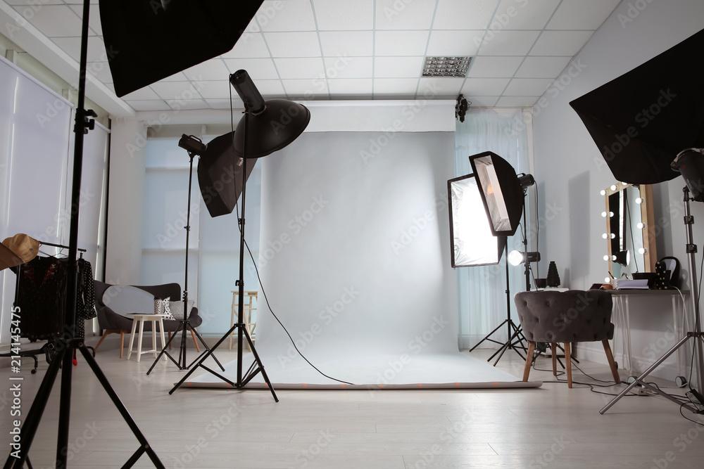 Fototapeta Interior of modern photo studio with professional equipment - obraz na płótnie