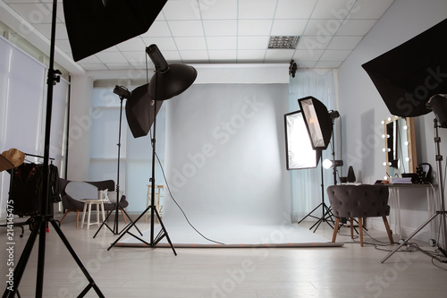 Canvastavla Interior of modern photo studio with professional equipment