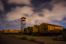 Old Army Watchtower In Abandoned Military Base At Night
