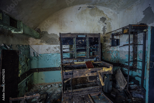 Photo  Abandoned underground Soviet communication bunker with remnant of equipment