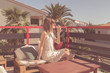 Girl drinking wine on a terrace outdoors.