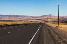 Palouse Country Highway Going In To The Distance In To Rolling Desert Hills