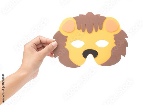 Fotografering  hand holding Lion animal carnival mask isolated on white background