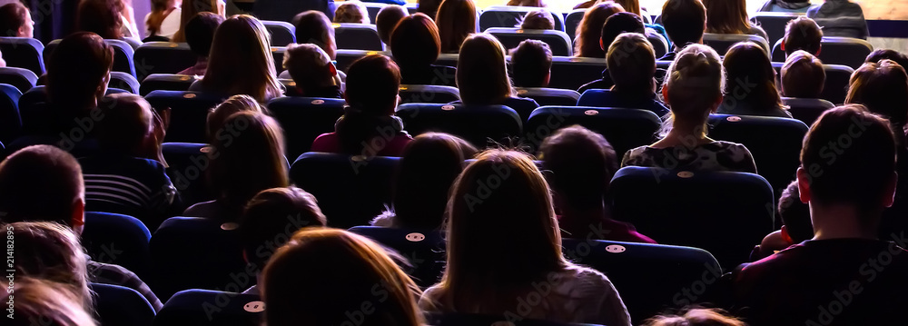 Fototapety, obrazy: People in the auditorium watching the performance