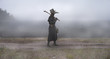 canvas print picture - Reconstruction of the medieval scene: the plague doctor on the way