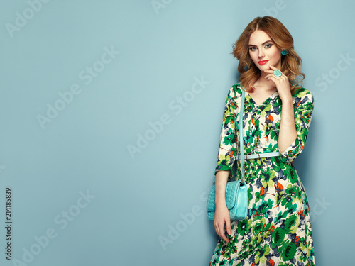 Blonde young woman in floral spring summer dress Fototapete