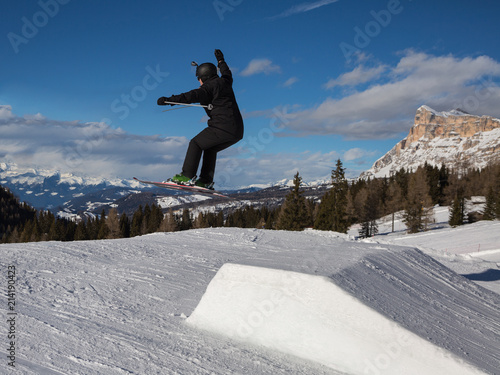 Fotobehang Wintersporten Skier in Action: Ski Jumping in the Mountain Snowpark