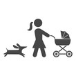 Mother with baby carriage walking with dog