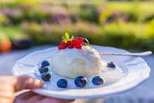 A Delicious Dessert With Steamed Dumpling And Freshly Picked Fruits.
