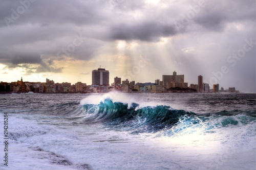 In de dag Havana Stormy weather hitting The Malecon in Havana, waves crash over the protective seawall in these dramatic weather images, Cuba