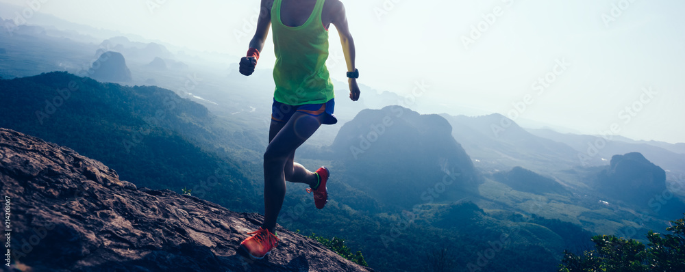 Fototapety, obrazy: woman running on mountain top cliff edge