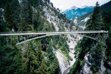 Obraz Suspension Bridge in Switzerland. Pedestrian hanging bridge over river in Alps