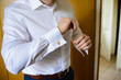 elegant man with white shirt and gold cufflinks