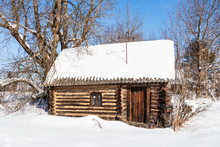 Snow-covered Little Typical Wooden Rural House