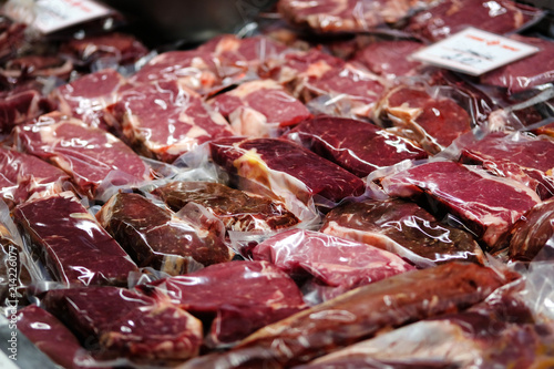 Fotografie, Obraz  Beef, veal, lamb fresh raw steaks are packaged in vacuum and sold on market