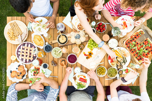 Top view on garden table with food during friend's party