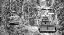 Empty Chair Lift In A Mountain Summer Scenario
