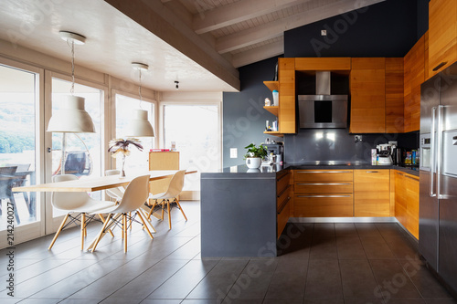 Obraz Front view modern wooden kitchen with table and chair - fototapety do salonu