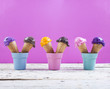 canvas print picture - Various ice-cream scoops on fuchsia background with assorted balls of blueberry, chocolate, strawberry and orange icecream in waffles