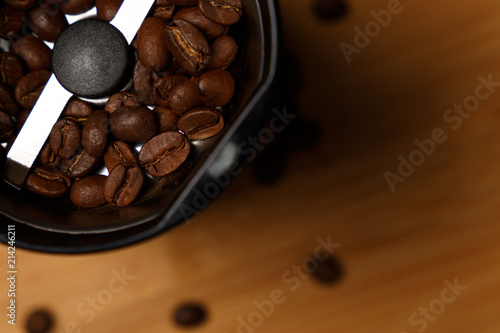Electric coffee grinder with roasted coffee beans on the kitchen table with blue tabletop Tapéta, Fotótapéta