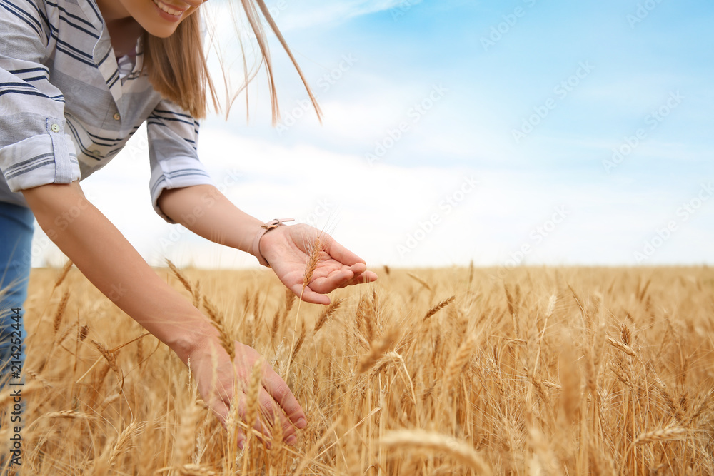 Fototapety, obrazy: Young agronomist in grain field. Cereal farming