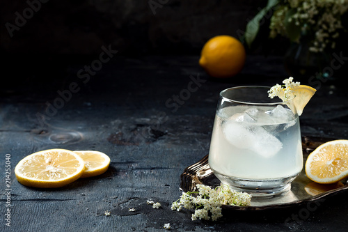A glass of homemade elderflower gin sour or lemonade garnished with freshly picked elderflowers Canvas Print