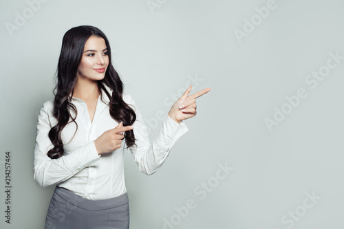 Successful businesswoman pointing her finger to empty copy space for  advertising marketing or product placement Fototapete