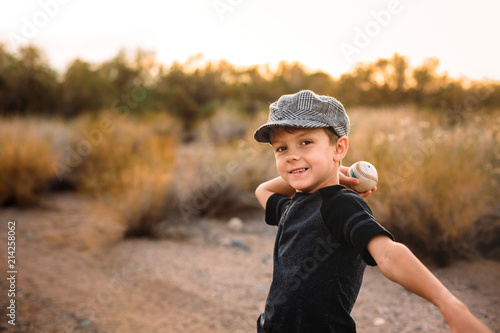 Little Boy about to Throw Baseball