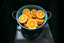 Cut Oranges In Strainer