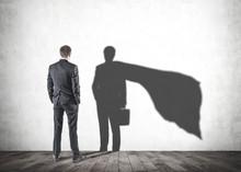 Businessman Looking At His Superman Shadow
