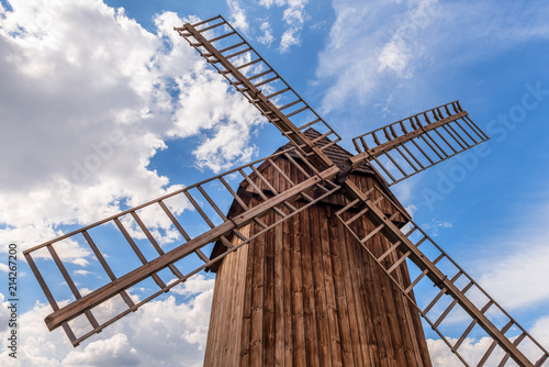 Traditional wooden windmill under blue sky. Poland.