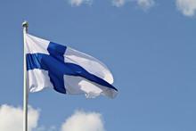 Finlands Flag Waving Against T...