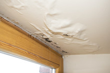 Water Damaged Ceiling Next To...