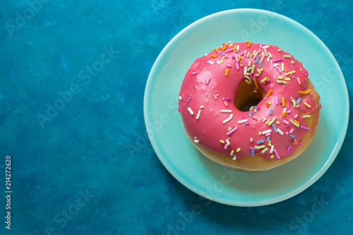 Pink Doughnut with Sprinkles on Blue Canvas Print