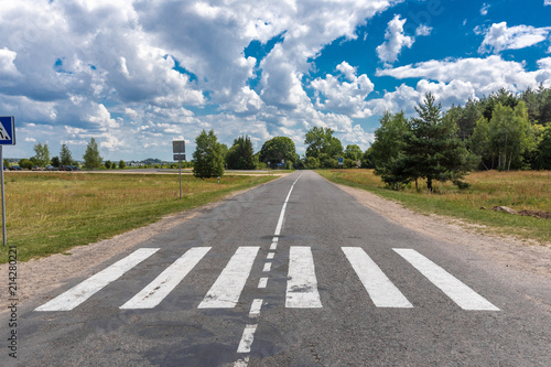 Foto op Aluminium Luchthaven pedestrian crossing in the forest and sky