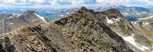 Rugged Mountains - A panoramic spring view of rugged west ridge of Mount Evan, humble Mount Bierstadt, and rolling high peaks of Front Range of Rocky Mountains, seen from summit of Mount Evan Fototapeta