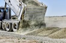 Dump Truck Spreading Gravel On...