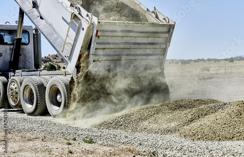 Dump Truck spreading Gravel on Driveway Canvas Print